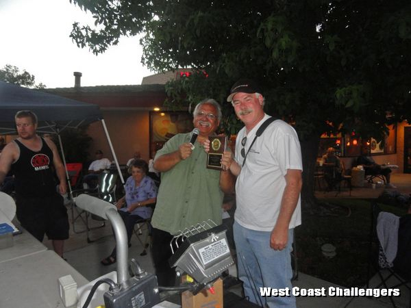 West Coast Challengers club President accepting the Club Participation Award on behalf of the club