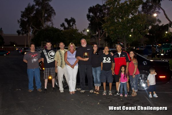 West Coast Challengers club members posing with the Club Participation Award after the event